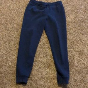 Navy sweatpants with small hole in knee